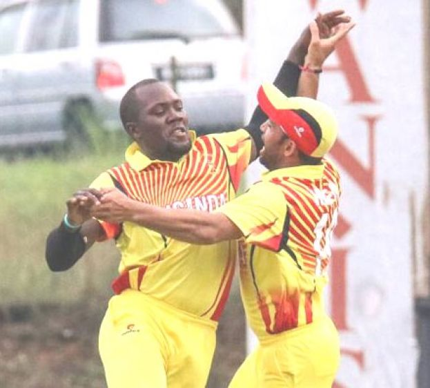Roger Mukasa and a colleague celebrate during a past game. Photo BY ICC/MCA