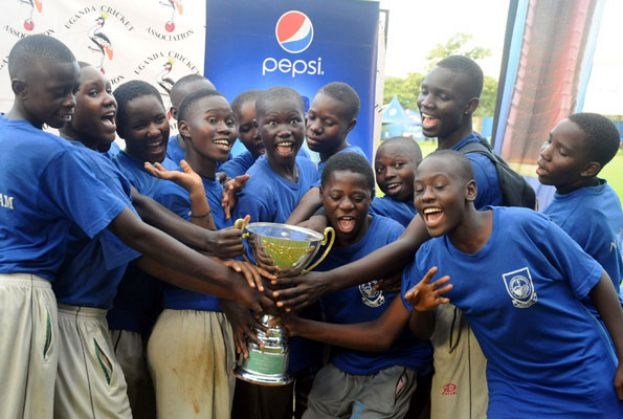 Jinja SS girls getting a feel of the trophy after emerging best in the Pepsi Girls Twenty20 Schools Cricket week. PHOTO BY EDDIE CHICCO