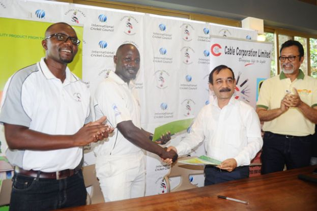 Landmark Deal. UCA chairman Ansasiira (2nd L) shakes hands with Mehta Group CEO Anil Shah (2nd R) after signing Memorandum of Understanding that will see the company pump at Shs45m into the team. PHOTO BY E. CHICCO